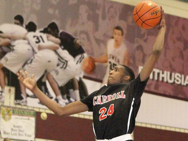 Archbishop Carroll's Derrick Jones goes up for a tomahawk dunk. (Charles Fox/Staff Photographer)