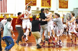 Haverford players go wild in celebration after upsetting reigning PIAA champ Lower Merion in a Central League match Wednesday night. (Paul Bogosian)