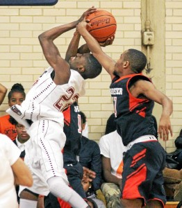 Penn Woodâ s Amadou Kaba, left, draws a foul from Chesterâ s Conrad Chambers in the first half of Thursdayâ s game at Penn Wood. The Patriots won the first meeting of the two rivals, 65-56. (Times Staff/ROBERT J. GURECKI)