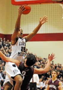 Lower Merion's Justin McFadden goes up for two and takes Conestoga's Dan Vila with him. Photo Pete Bannan (Pete Bannan)
