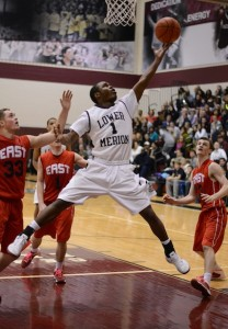 JaQuan Johnson '14 scored 15 points and had seven assists in the Aces' win over CB East.