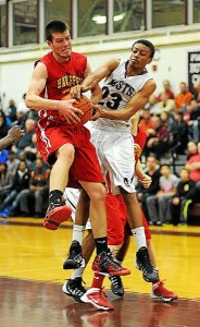 Haverford's Jack Donaghy and Abington's Anthony Lee fight for a rebound during Tuesday's playoff game at Abington. Montgomery Media staff photo / SCOTT ROMAN