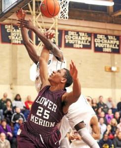 Lower Merion's Justin McFadden breaks up Penn Wood' Amadou Kaba's drive to the basket. (Robert J Gurecki)