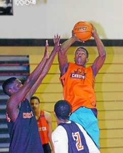 Gabe Adesina, a 6'8 center for Chester make a shot during practice, Monday. (Times Staff / JULIA WILKINSON)