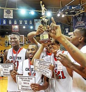 Some of Chester's players are showing off the District 1 championship trophy at Villanova. Times Staff/ROBERT J. GURECKI.