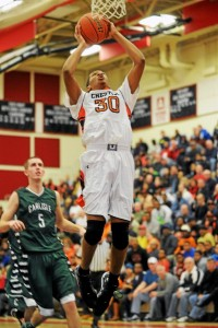 Chester guard Brewster Ward prepares to dunk the ball during a AAAA playoff game against Carlisle High School in Coatesville, Saturday. (Times Staff / JULIA WILKINSON)