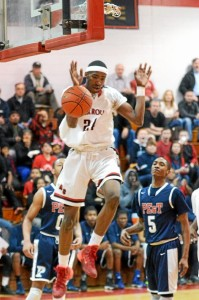 Derrick Jones lets go of the ball after dunking on Philadelphia Electric and Technical Charter School in the first quarter of their Class AAA quarter final game at Archbishop Ryan High School, Friday. (Times Staff / JULIA WILKINSON)