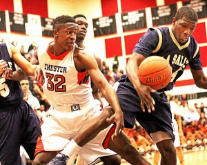 """Chester's Adeolu """"Gabe"""" Adesina, left, slaps the rebound away from Shawn Witherspoon in the state semi-final held at Coatesville. Times Staff/ROBERT J. GURECKI."""