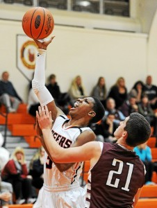 Marple Newtown's Marcus Weathers (3) goes up for a layup past Garnet Valley's Jack Diggory (21) Tuesday night. (Tom Kelly IV)