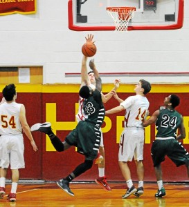 Haverford's Sean McClatchy, 11, blocks a layup from Ridley's Ameer Staggs in the final moments of Friday's game. The Fords held on for a 35-34 win. (Tom Kelly IV)