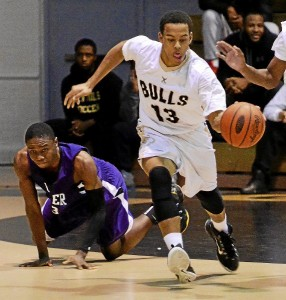 Glen Mills' Steven Welsh, right, goes the other way after a steal in the second quarter of the Bulls' 59-44 win over Upper Darby Saturday. (Tom Kelly IV)