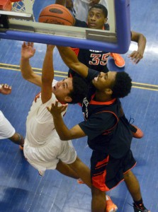 William Penn's Brandon Smallwood goes up for a shot against Chester's Juanir Moore in the second half of Saturday's game. In a tightly-contested game, William Penn lost by a point to a powerful Chester program. (Chris Dunn — gametimepa.com)