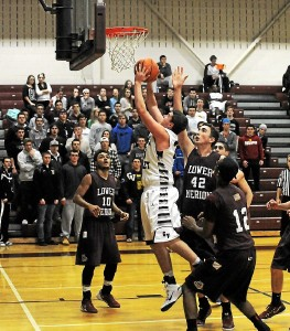 Garnet Valley's Austin Klenotiz looks for two of his game-high 22 points against Lower Merion Dec. 16. After a slow start to the season, the senior forward has turned up the scoring of late. (Rob Dudley)