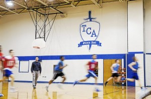 The Christian Academy boys basketball coach Jon Thompson watches as players complete sprints at a recent practice. TCA aims to join the PIAA starting next academic year, moving its athletics from the Tri-State Christian Conference. (Rick Kauffman)