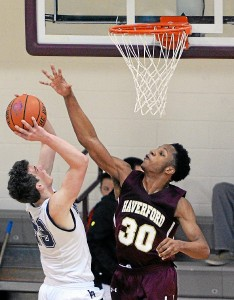 Haverford School's Lamar Stevens, right, defends a shot by Episcopal Academy's Nick Alikakos Saturday. Stevens scored 24 points and picked up 17 rebounds as the Fords topped the Churchmen, 57-46, at Philadelphia University. (Tom Kelly IV)