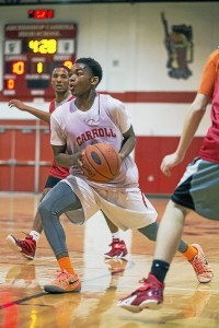 Josh Sharkey drives the lane at Archbishop Carroll basketball practice earlier in the season. Sharkey scored 21 points, but the Patriots dropped a 71-69 decision to Neumann-Goretti. (Rick Kauffman)