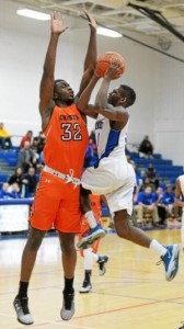 Academy Park's Travis Smith, right, goes up for a shot under the defense of Chester's Maurice Henry in the first half Wednesday. The Knights scored a 51-48, buzzer-beating win. (Tom Kelly IV)
