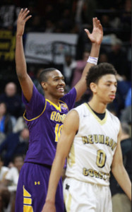 Roman Catholic's Tony Carr raises his arms as the outcome of the game becomes apparent in the closing seconds. (Charles Fox/Staff Photographer)