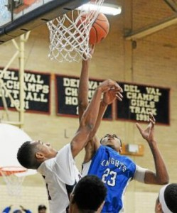 Academy Park's Lashon Mapp, right, here dropping in a layup over Penn Wood's Malik Jackson, has the kind of shot-blocking skills that enable the Knights to gamble on defense with the knowledge that Mapp is capable of erasing any mistakes. (Tom Kelly IV)