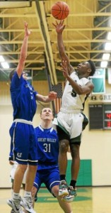 Ridley's Brett Foster, left, goes up for a shot over Great Valley;s Doug Strang, center, and Ryan Buchholz during the Green Raiders' 57-40 win Tuesday night. (Tom Kelly IV)