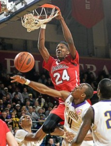 Archbishop Carroll's Derrick Jones jams home a rebound over Roman Catholic's Nazeer Bostick during the Patriots' 61-58 loss in a Catholic League semifinal game Wednesday at the Palestra. Jones had 23 points and 14 rebounds, but it wasn't enough for Carroll to overcome the Cahillites. (Tom Kelly IV)