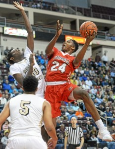 Archbishop Carrollâ s Derrick Jones, right, challenges Neumann-Gorettiâ s Dhamir Cosby-Roundtree in the first half of the Patriotsâ 69-67 loss in the PIAA Class AAA championship game Friday night. Jones was spectacular in defeat in his final scholastic game, scoring 30 points, grabbing 18 rebounds and blocking five shots. (Tom Kelly IV)