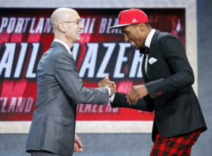 Rondae Hollis-Jefferson shows a bit of Chester flair as he greets NBA Commissioner Adam Silver after being selected 23rd overall by Portland during Thursday's NBA Draft in New York. KATHY WILLENS — THE ASSOCIATED PRESS