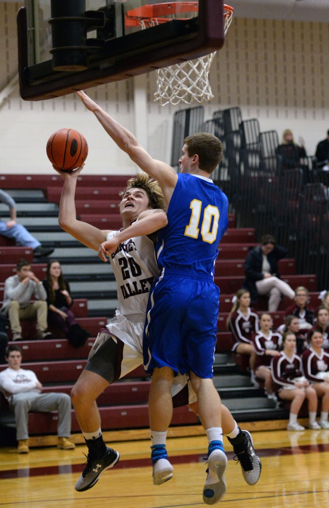 TOM KELLY IV - DAILYLOCAL Garnet Valley's Ryan McCrossan (20) has a layup blocked by Springfield's Nick Fox (10) during the Springfield at Garnet Valley boys basketball on Tuesday night.